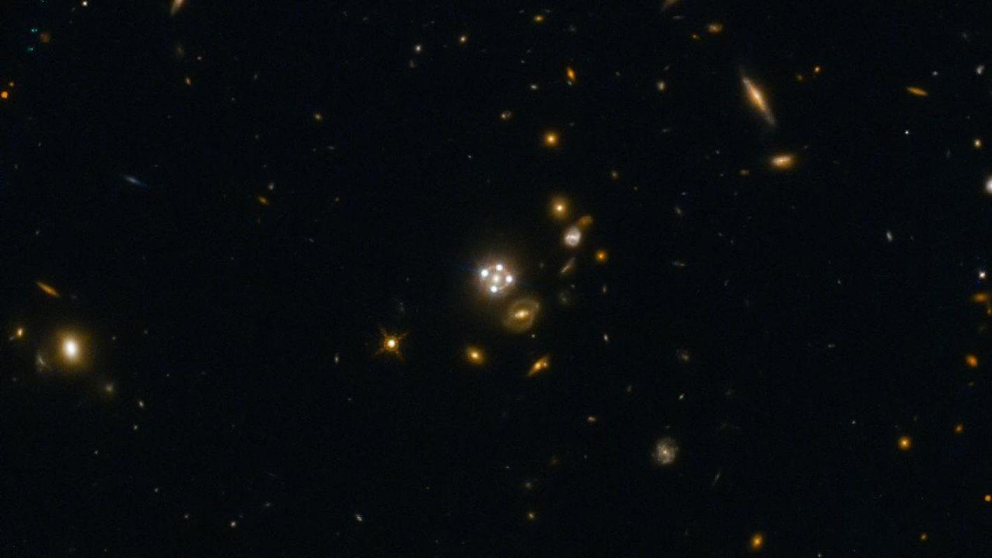 Происхождение во Вселенной золота  и других тяжелых элементов