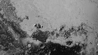 Космический зонд «Новые Горизонты» прислал высококачественные фотоснимки Плутона, демонстрирующие рельеф его поверхности