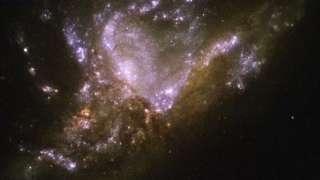 «Хаббл» сфотографировал процесс слияния двух галактик