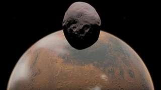 Учёные пытаются разгадать секрет двух спутников Марса