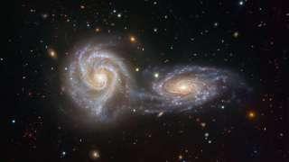 Астрономы показали фотоснимок, запечатлевший столкновение двух галактик в 110 миллионах световых лет от Земли