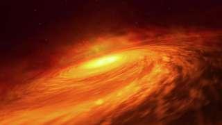 Астрономы обнаружили таинственный газопылевой диск у «спящей» гигантской черной дыры